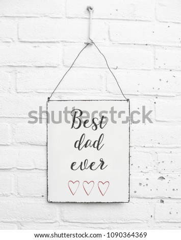 White square metal plate on white bricks background - mock up template - Best dad ever in the world - for daddy with cute red hearts #1090364369
