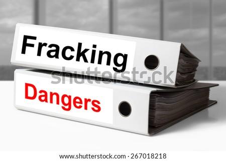 white stack of office binders fracking dangers