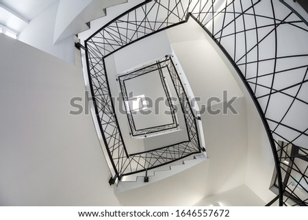 white stairs  emergency and evacuation exit spiral stair in up ladder in a new office building