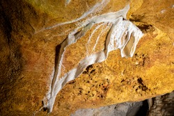 White stalactite formation on the clay ceiling of the cave. Mallorca. Spain.