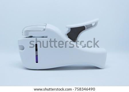 White  Staple less  stapler