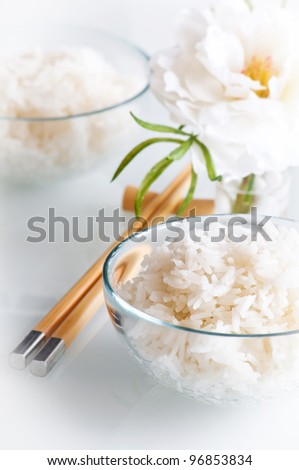 White steamed rice in round bowl and chopstick