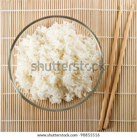 white steamed rice with sticks on bamboo background