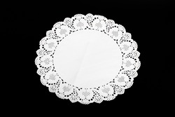 white stencil doily paper-like a flower on wood table