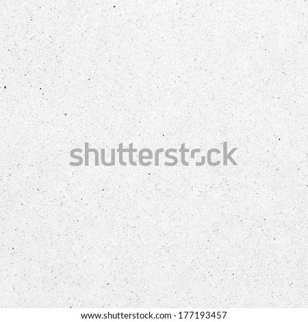 White stone texture with black and gray dots. Granite background
