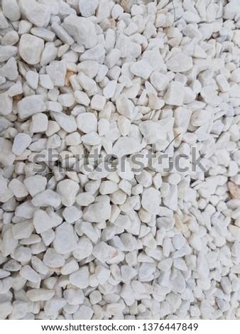 White stones, crushed stone. Background, texture.
