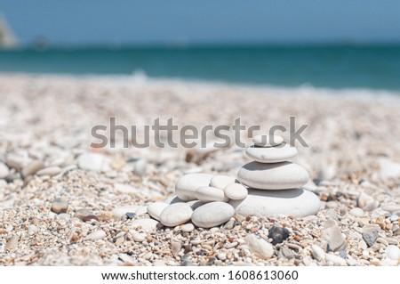 White stones on the sea beach background