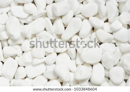 white stones, white background, white decorative stones, aquarium stones, stones for the garden #1033848604
