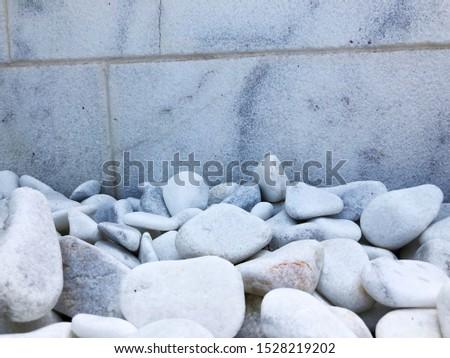 white stones, white background, white decorative stones, aquarium stones, stones for the garden.