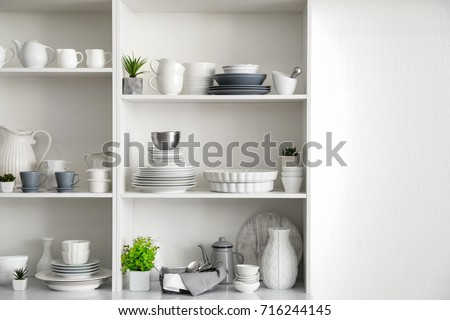White storage stand with ceramic dishware in kitchen