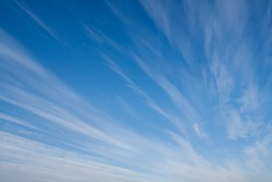 White streaks of clouds in the blue sky