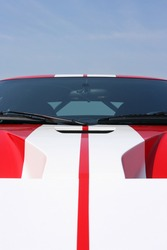 White stripes on a red super car bonnet