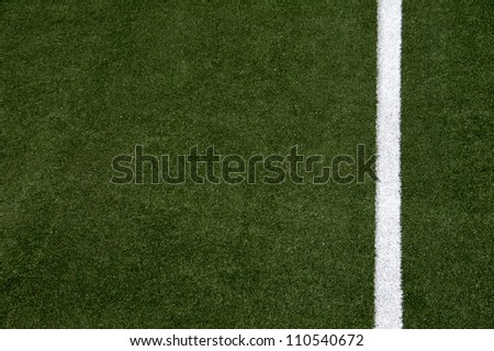 White stripes on the green soccer field from top view
