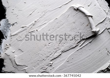 white Structural plaster on black wall