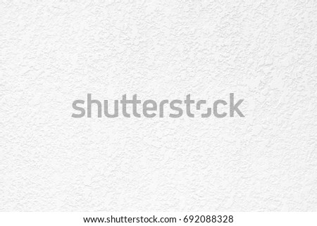 White stucco wall background. White painted cement wall texture - Shutterstock ID 692088328