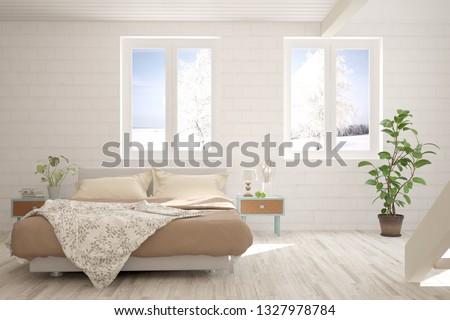 White stylish minimalist bedroom with winter landscape in window. Scandinavian interior design. 3D illustration