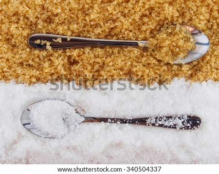 White sugar and brown sugar , and spoon