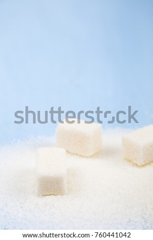 White sugar and cubes of sugar on an old wooden background, top view. #760441042