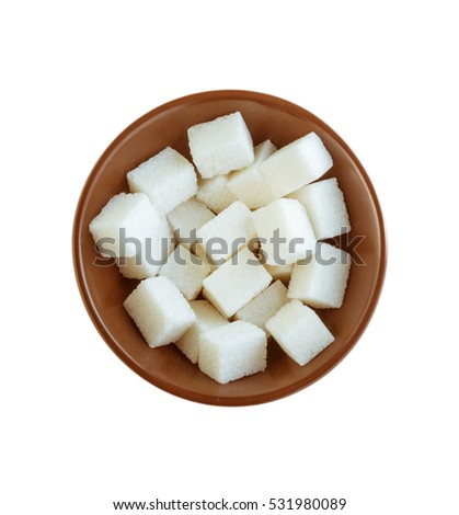 White sugar cubes in bowl on white background #531980089