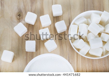 White sugar in a white bowls on the table #441471682