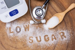 White sugar in wooden scoop and words