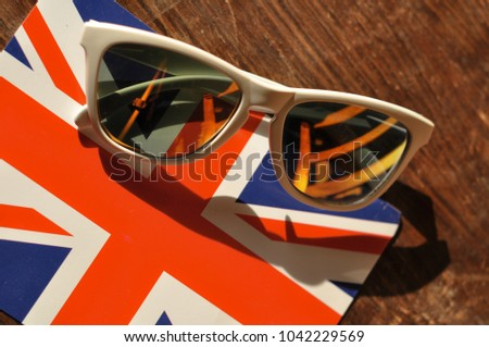 white sunglasses laying on the...