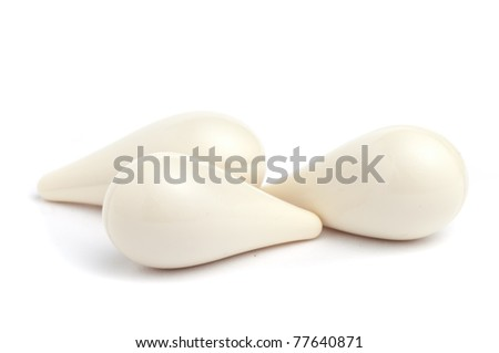 White suppositories on a white seamless background