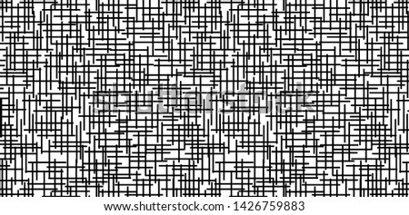 White surface and black patterned background