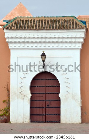 White surround to a massive wooden door on this entrance to the Koutoubia Mosque, Marrakesh