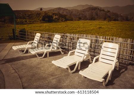 white swimming pool chair near...