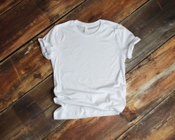 White T Shirt mockup flat lay on rustic brown wood background