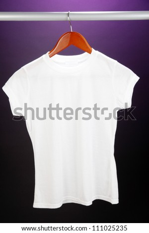 White t-shirt on hanger on purple background