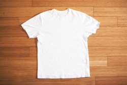 white t shirt on wood floor, mock up, free space