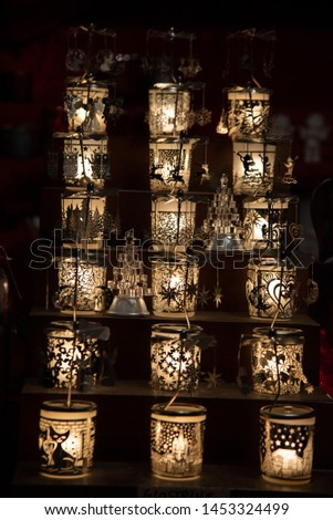 White table lanterns with black festive decorations. Christmas decorations and for year-end celebrations.