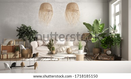 White table top or shelf with minimalistic bird ornament, birdie knick - knack over blurred vintage living room with sofa, lounge, carpet, potted plants, retro interior design, 3d illustration Foto stock ©