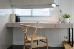white table with wooden chair and books in modern working area at home