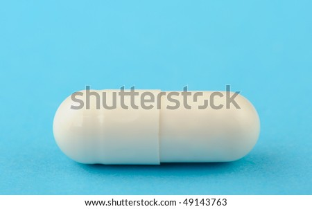 White tablet on a blue background. A photo close up