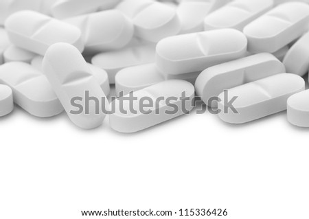 White tablet pills with copy space , isolated