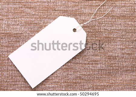 White tag on brown texture