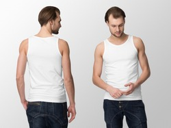 White tank top on a young man in jeans, isolated, front and back, mockup.