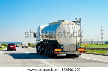 White Tanker storage truck on the asphalt highway of Poland. Business industrial concept. #1225461202