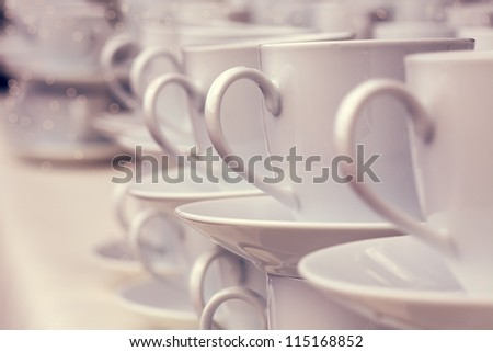 White tea cup standing in a row