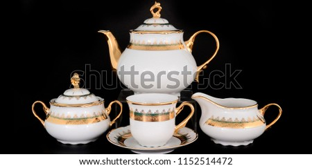 white tea set with golden pattern