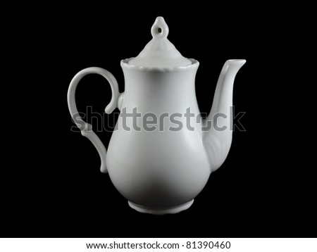 White teapot made of porcelain over black background