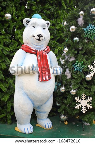 white teddy bear with decorations under the Christmas tree