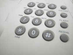 White telephone on desk, Macro of phone keypad - business background, Phone button,Close up shot of phone keypad, Telephone Keypad with Buttons. Numbers and Letters. close up