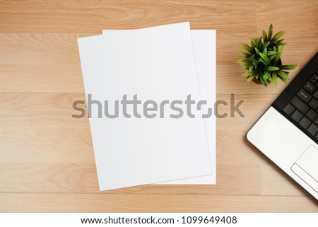 White template paper and space for text on wooden desk #1099649408