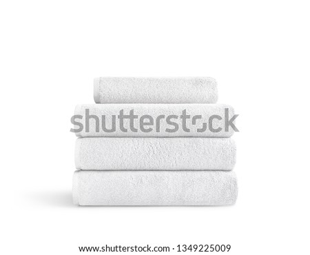 White terry towels in stack against white backdrop, folded soft bath towels, stack of white cotton towels on a white background