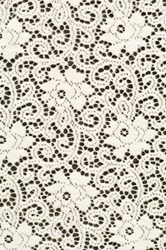 White textile background with stylized flowers pattern