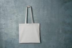 White textile bag on grey background